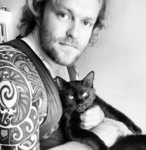 Photo of Ryan Kahlor and his rescued shelter cat taken by Hannah Kahlor.