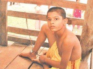 Young Boy chained